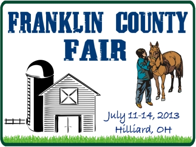 County Fair yard sign with colored pictures of a horse and barn